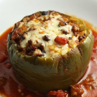 Green bell pepper stuffed with beef, tomatoes, beans, corn.