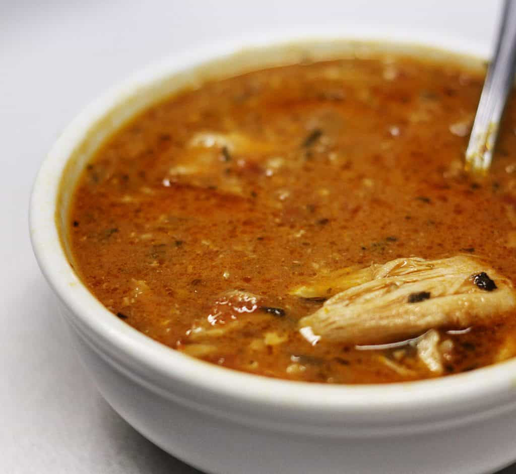 Chipotle chicken soup in a white bowl