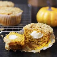 Gluten Free Pumpkin Cream cheese muffin cut in half