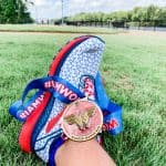 Running shoe with medal